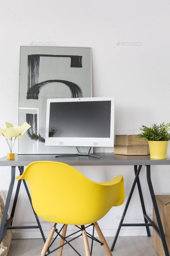 Desk, computer and yellow chair - Stock Photo - Images