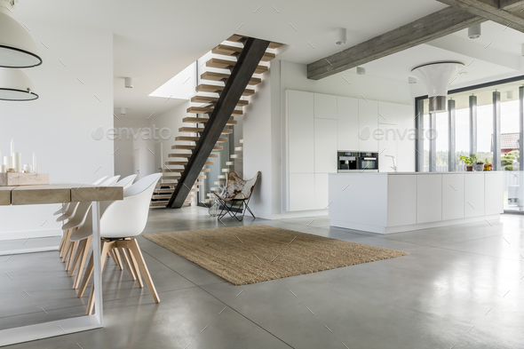 Open floor apartment with staircase - Stock Photo - Images