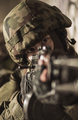 Soldier in helmet pointing a gun