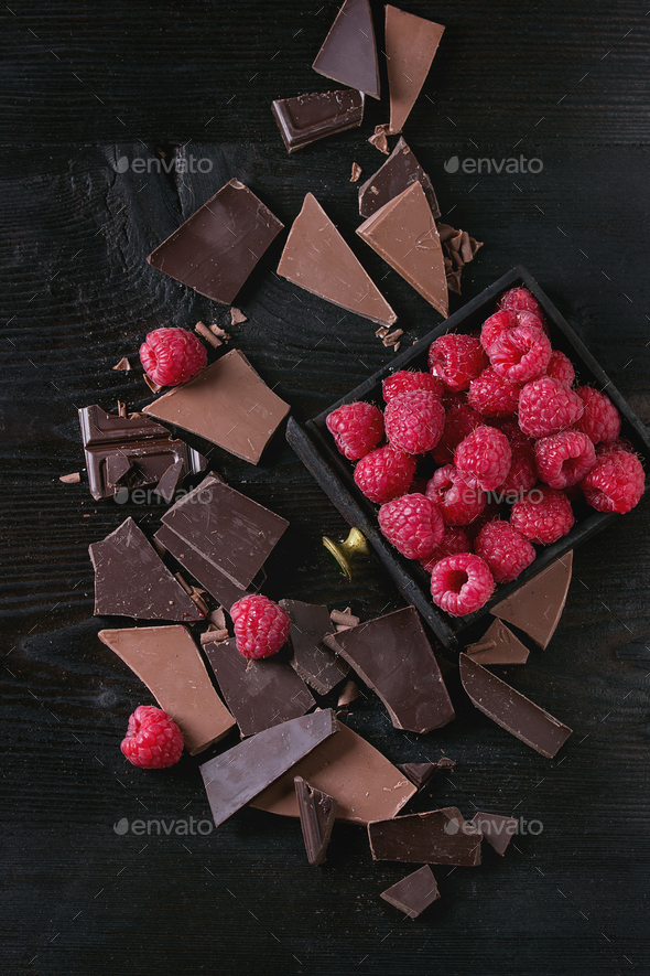 Variety of chopping chocolate with raspberries - Stock Photo - Images