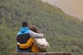 Young couple enjoying green forest at sunset. Norway landscape. Tourism. Horizontal