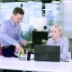 Young Businessman Entertain a Female Coworker with Juggling - VideoHive Item for Sale