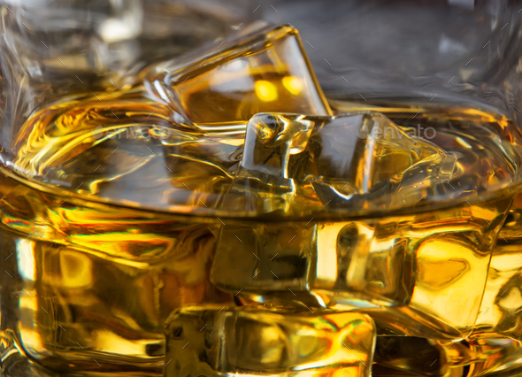 Ice in glass of whiskey macro - Stock Photo - Images