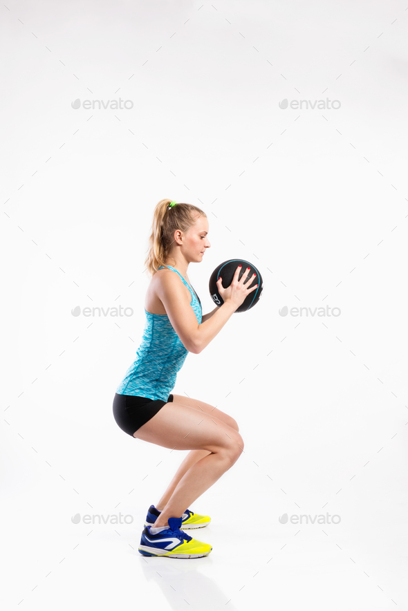 Young fitness woman with medicine ball  Studio shot