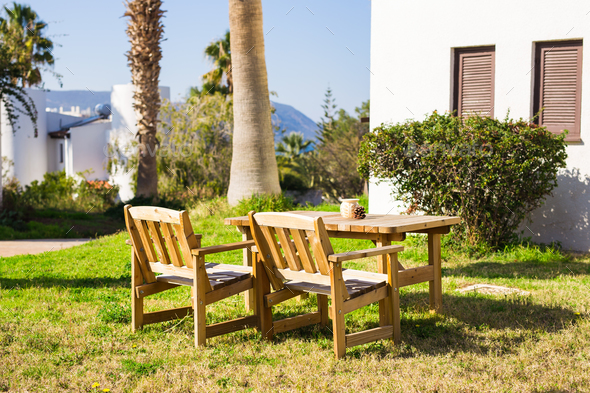 Outdoor furniture. Lounge chairs in hotel garden invite you to relax