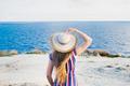 woman enjoying beach relaxing joyful in summer by tropical blue water - PhotoDune Item for Sale