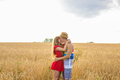 young couple kissing in a field - PhotoDune Item for Sale