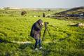 photographer or traveller using a professional DSLR camera - PhotoDune Item for Sale