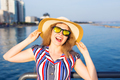 woman wearing sunglasses and hat on beach over sea - PhotoDune Item for Sale