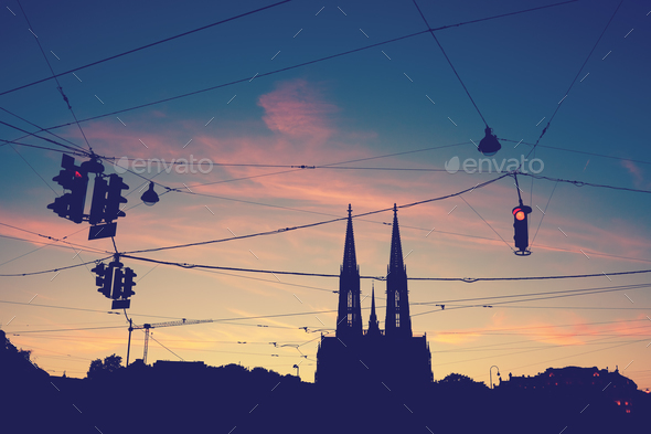 Silhouette of the Votive Church and stoplights at dusk. - Stock Photo - Images