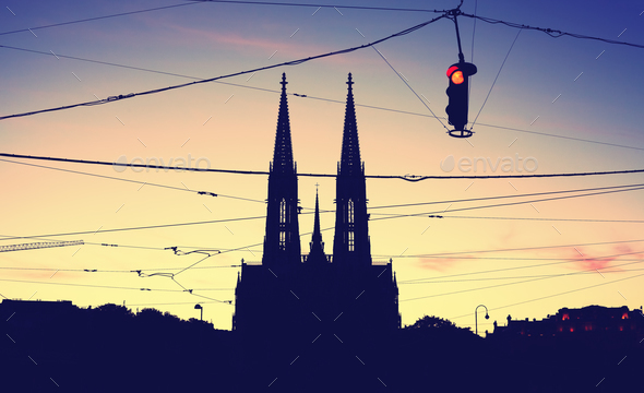 Silhouette of the Votive Church and stoplight at dusk. - Stock Photo - Images