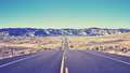 Vintage toned desert asphalt road, moving forward concept, USA