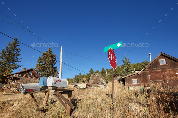 Old mail boxes and stop sign in remote village. - Stock Photo - Images