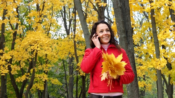 VideoHive Girl Talking on a Cell Phone in the Park 19843181
