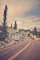 Vintage toned scenic road in Yellowstone National Park.