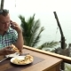Man is Eating Pizza and Talking on the Phone - VideoHive Item for Sale