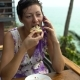Girl is Eating Pizza and Talking on the Phone - VideoHive Item for Sale