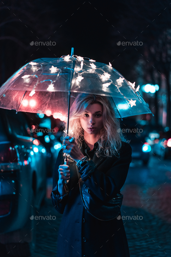 Under the light of an umbrella - Stock Photo - Images