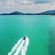 Top View of Speed Boat Approaching To Jetty Over Clear Blue Sea Water - VideoHive Item for Sale