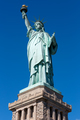 Statue of Liberty and pedestal on clear dark blue sky in a sunny