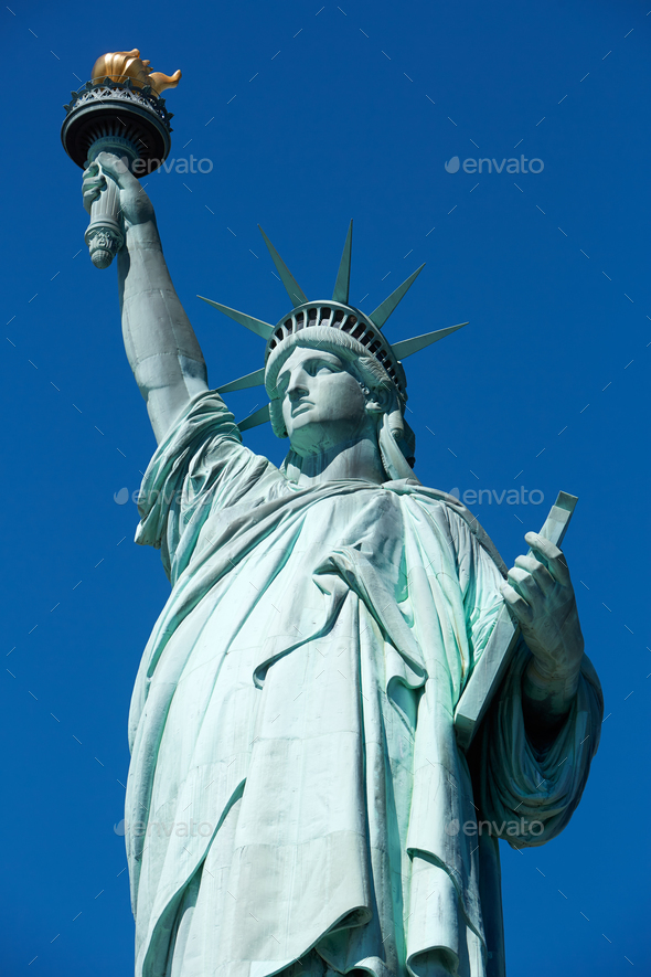 Statue of Liberty, clear blue sky in a sunny day in New York - Stock Photo - Images