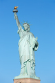 Statue of Liberty in New York, clear blue sky in a sunny day, cl