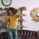 Young Beautiful and Slim Happy African Woman Dance and Jump Alone at Home