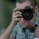 Young Man Taking Pictures At A Professional Digital Slr Camera - VideoHive Item for Sale