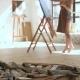 Girl Paints Picture of Oil Standing Barefoot on Floor Studio