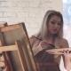 Girl Artist with Palette in Hands Creates Her Brilliant Masterpiece