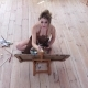Artist Woman Paints Masterpiece Sitting on the Floor