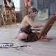 Professional Artist Draws Picture Sitting on the Floor Her Workshop