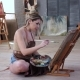 Artist Girl Draws Picture Sitting on the Floor in Art Workshop