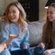 Three Young and Energetic Best Friend Girls Talk Together Emotionally and Lively
