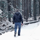 Man Walks In Forest With Snow Falling - VideoHive Item for Sale