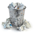 Trash bin full of waste paper. Wastepaper basket isolated on whi