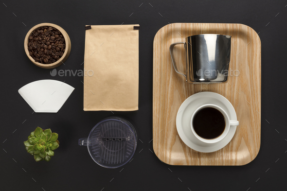 Top view of a black desk with coffee hand brewing supplies - Stock Photo - Images