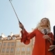 Two Young Women Tourists with Selfie Stick in Town - VideoHive Item for Sale