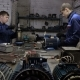 Two Workers Repair the Electric Motors. Repair of Industrial Electric Motor.