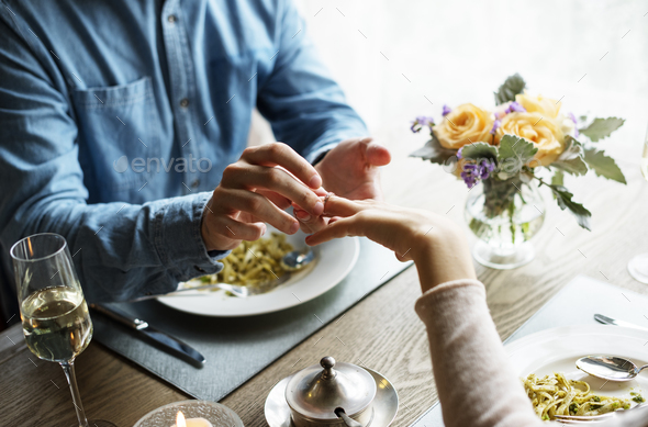 Romantic Man Giving a Ring to Propose Woman on a Date - Stock Photo - Images