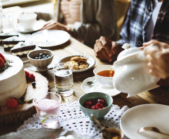 Friends Gathering Together on Tea Party Eating Cakes Enjoyment h - Stock Photo - Images