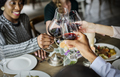 People Clinging Wine Glasses Together in Restaurant - PhotoDune Item for Sale