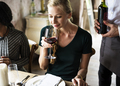 Woman Tasting Red Wine in a Classy Restaurant