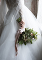 Attractive Beautiful Bride Holding Flowers Bouquet - PhotoDune Item for Sale