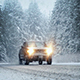 Cars Drive Through Forest In Snowstorm - VideoHive Item for Sale