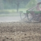 Tractor Plowing Field in Summer