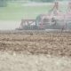 Agricultural Tractor Cultivating Field