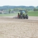 Agricultural Tractor Cultivates Field