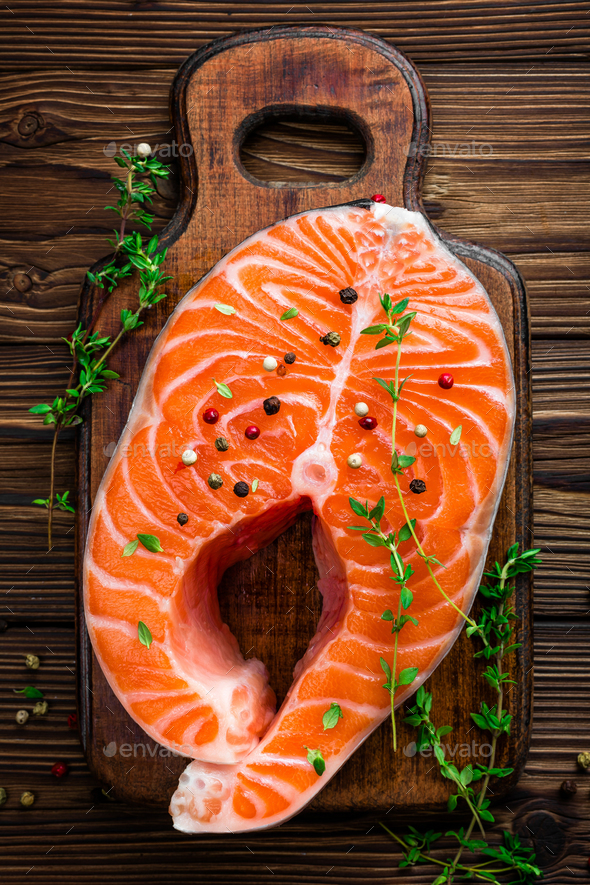 Salmon fish steak on wooden rustic background top view - Stock Photo - Images