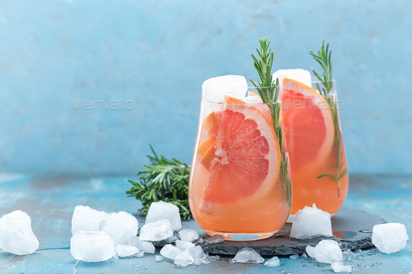 Grapefruit and thyme gin cocktail, refreshing drink with ice - Stock Photo - Images